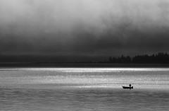 Dubious fishing day (Patty Bauchman) Tags: fishing fishingboat yellowstonelake yellowstonenationalpark storm stormyskies nature weather badweather niksilverefexpro blackandwhite