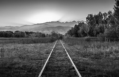 symphony of nature (andy_8357) Tags: blackandwhite monochrome outdoors railroad tracks bw foothills mountain mountains boulder colorado sunset sunrays rays sun grass tree trees sony sel1650 e pz 1650mm mirrorless wideangle wide angle ilcenex ilce6000 a6000 6000 sky selp1650 alpha blanco y noir negro blancoynegro