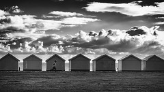 Escaped (Fourteenfoottiger) Tags: escape freedom child people candid monochrome mono blackandwhite beachhuts beach hove brighton seaside seafront cloudscape clouds sky contrast stormy running sea