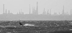 Solent Windsurfer (Invisible Edit) Tags: windsurfer kitesurfer sea water southampton fawley refinery coast sport waves surf wind