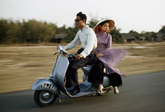 color vietnam chi minh women|young people|young adult|young culture|traditional image|day|outdoors|photography|vietnam|south vietnam|saigon|ho ethnicity|vietnamese men|vietnamese city|two clothing|motor|scooters|blurred motion|stylish|driving|sunglasses|passengers|couples|horizontal
