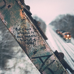 """...and miles to go before I sleep."" (D A Baker) Tags: locomotive diesel engine pulling rail road cars railroad track parallel rust rusty iron quote passage poem winter robert frost poet indiana rural snow ice overcase promises keep andmiles go before i sleep fujifilm x100s train country laureate well read danielbaker daniel baker dan da danielabaker"