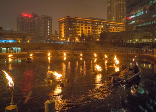Fire tenders leave an inky wake in the Waterplace Park Basin. Photo by Jennifer Bedford.