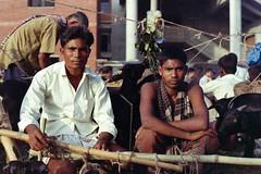 Goat Sellers #001 (Sheikh Shahriar Ahmed) Tags: street portrait man men film analog cattle market eid goat fujifilm dhaka bangladesh seller banasree eiduladha hexanon50mmf17 fujicolorc200 dhakadivision ঈদ pacificimage aftabnagar konicaautoreflext3n sheikhshahriarahmed হাট গরুর ব্যাপারী primefilm3650pro3 ছাগলের