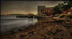 LaHave Bakery (Carolyn Little) Tags: ocean red building tree texture beach water landscape sand rocks novascotia stones bakery wharf lahave