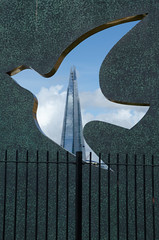 Blitz memorial (Spannarama) Tags: shard blitzmemorial hermitageriversidememorialgarden memorial sculpture dove cutout railings fence sunshine sunlight clouds blueskies london uk