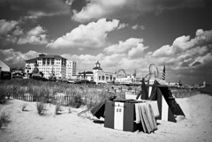 S47-R1-065 (David Swift Photography Thanks for 16 million view) Tags: davidswiftphotography newjersey oceancity beaches boardwalk amusements rides sand umbrellas surfboards flandershotel dunes dunefence clouds 35mm film ilfordxp2 yashicat4 resorts seashore