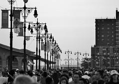 The Boardwalk (KaDeWeGirl) Tags: newyorkcity brooklyn coneyisland boardwalk vintage lamps street lights summer crowd bw