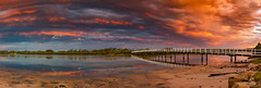 Stuarts Point Footbridge (Photography By Tara Gowen) Tags: panorama sunset bridge river water orange colours sky clouds blue nikon australia nsw taragowen photographybytaragowen stuartspoint