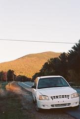 Road Trip Companion (Nsharp17) Tags: nikon nikonfe film 35mm kodak ektar ektar100 car hyundaiaccent hyundai road vermont mountain foliage autumn fall orange goldenhour