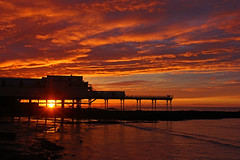 A Surreal Sunset... (John Ibbotson (catching up!)) Tags: sunset sea sky sun silhouette wales clouds coast pier aberystwyth promenade ceredigion