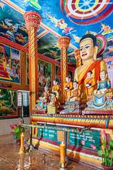 Lolei (Electricity Mule) Tags: statue temple shrine colorful cambodia candles candle buddha buddhist religion buddhism indoors inside siemreap angkor wat buddism buddist