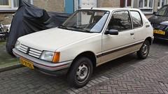 Peugeot 205 3-Door 1.1 XE (sjoerd.wijsman) Tags: auto holland cars netherlands car beige den nederland thenetherlands denhaag voiture vehicle holanda hatch autos haag paysbas peugeot olanda hatchback fahrzeug niederlande 205 zuidholland peugeot205 onk carspotting carspot sidecode4 rx91dl