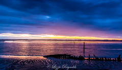This evenings sunset over the mudflats of Breydon Water after the terrible thunder storm earlier today. (lizzieisdizzy) Tags: sundown cloud cloudy coloured evening relaxing reflections ripples wooden wreck shadow posts marker channel broad lake