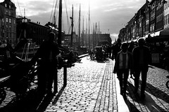walk at the harbor (www.carbonat380.de) Tags: 1235mm 28 denmark dnemark gx7 kobenhavn kopenhagen lumix mft microfourthirds panasonic panasonicgx7 x backlighting black blackandwhitephotography harbor monochrome people pointandshoot shadow silhouette street touristarea tourists travel travelphotography walking white