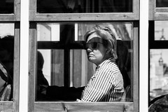 'The Reluctant Tourist' (Canadapt) Tags: woman tourist tram trolley streetcar window shadow sunglasses pout bw alfama lisbon portugal canadapt