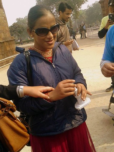Accessible Tour of Qutub Minar: Binny, a young traveller who is blind, is seen in the photo with a miniature version of the Qutub Minar, which she can feel to understand more about the architecture.