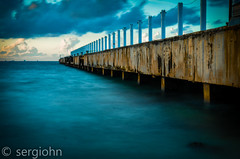 Long wait at the dock... (sergiohnpics) Tags: pier dock shore sea longexposure photography beach boat
