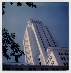 L.A. City Hall 11 (tobysx70) Tags: the impossible project tip polaroid sx70sonar sonar instant color film for sx70 type cameras impossaroid la city hall dtla downtown los angeles california ca skyscraper highrise government office building blue sky leaves silhouette dtlapolawalj2 polawalk 071616 toby hancock photography