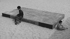 Busking Zone (Mondmann) Tags: buskingzone haeundae haeundaebeach busan korea southkorea rok republicofkorea asia eastasia boys kids children sand stage pusan bw pb mondmann canonpowershotg7x sitting beach