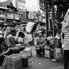 Market along the Main Street (Purple Field) Tags: rolleiflex t tlr carl zeiss tessar 75mm f35 ilford delta iso400 bw monochrome film analog 6x6 120 medium square yogyakarta indonesia street walking people market                    canoscan8800f stphotographia