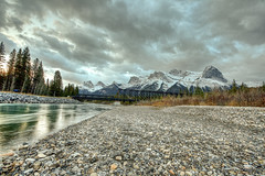 The Bow River (The Byrne Files) Tags: river canmore alberta canada water sky bridge clouds stones trees mountains snow byrneimagescom