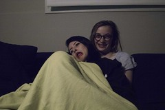 Sophia & Em (lordgogurt) Tags: lighting girls people house home girl dark person cozy room indoors blanket laugh tungsten