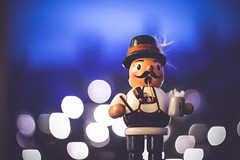 Raeuchermaennchen (thethomsn) Tags: blue winter blur colour cute hat night germany dark bayern deutschland lights focus dof puppet nacht bokeh hut faded german dreamy bier dunkel krug deutsch bavarian räuchermännchen bayer lederhosn 50mmf14usm bokehlicious eos600d