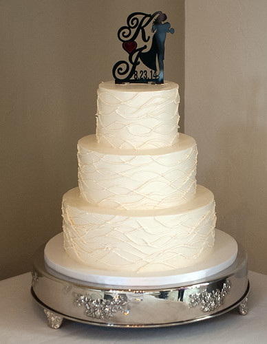 """A buttercream wedding cake.  Simple and Sweet • <a style=""""font-size:0.8em;"""" href=""""http://www.flickr.com/photos/50891271@N03/16160332348/"""" target=""""_blank"""">View on Flickr</a>"""