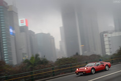 Ferrari 328 GTS in front of the foggy buildings of Wanchai in Hong Kong (Ben Molloy Automotive Photography) Tags: city morning sky hk motion car photography dawn cityscape ben foggy automotive 328 hong kong vehicle molloy scraper gts ferrrai