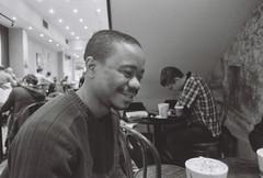 in caffe nero (arcibald) Tags: cambridge england film nikon unitedkingdom 400 pan caffenero ilford fm2 marketsquare