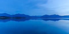 blue (hjuengst) Tags: blue mountain lake alps bayern bavaria wideangle bluesky berge bluehour alpen blau chiemsee blauestunde weitwinkel bavariansea