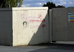 Latin Graffiti (john atte kiln) Tags: latin graffiti funny humour humor correction incorrect southwell nottinghamshire england britain uk unitedkingdom wall plywood plywoodwall temporarywall dirty sunny