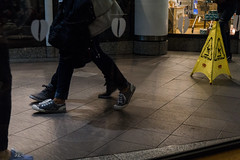Instruction #11-702-3 (Doowopski) Tags: doowopski street streetrepeat106 feet catch step catchfeetinstep streetphotography caution cautionsign instep throughawindow shoes legs