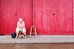 Bristol; July 2016 (Daniel Durrans) Tags: bristol mshed urban bag bags blocksofcolour colour harbourside lady metaldoor oldage oldlady oldwoman red sitting stool street streetphotography woman