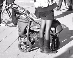 Shiny Mom (floressas.desesseintes) Tags: berlin kreuzberg mehringdamm mutter mother jungemutter youngmother silky shiny strmpfe stockings schimmern streetfotografie schwarzweis jungefrau youngwoman