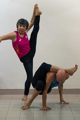 Gran and the Yogi (winniegotmilk) Tags: yoga yogi granny malaysia asia nikon