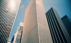 Towering (Jim Davies) Tags: photography analogue film veebotique 35mm vivitar ultrawideandslim uws plastic toycamera kodak ektachrome 160t 160asa slidefilm crossprocessed xpro e6 c41 expired hardexpired newyorkcity nyc newyork manhattan bigapple