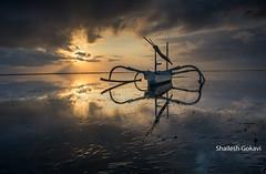 Colorful mornings .. (segokavi) Tags: bali sanur boat reflections beach seaweed pantaikarang morning sunrise colourful
