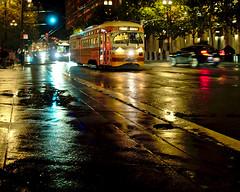 Rain at night means nice lights! (ant0ine) Tags: sanfrancisco california streetcar streetphotography night rain marketstreet