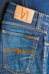 Blank leather jeans label sewed on a blue jeans (absolute_nt) Tags: old blue white detail macro classic texture thread leather fashion closeup back clothing sticker stitch background empty label tag style nobody retro wear inner yellowflower canvas clear jeans textile fabric cotton blank frame worn trousers backdrop denim casual material inside cloth seam apparel sewed revival garment advertise shabby coarse threadbare