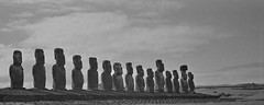 fifteen (SqueakyMarmot) Tags: chile travel blackandwhite bw southamerica 35mm polynesia toycamera statues panoramic southpacific scanned cropped filmcamera moai easterisland sculptures plasticcamera rapanui rockcarvings isladepascua anscopixpanorama monolithic ahutongariki 2015 ilforddelta100 humanfigures lofiphotography