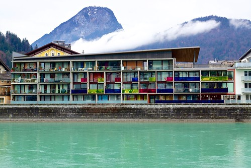 Apartment building next to the river Inn with the Pendling mountain in the background in Kufstein, Austria
