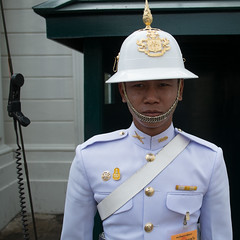 Palace Guard (the underlord) Tags: travel vacation holiday thailand phone bangkok guard palace grandpalace fujixpro1