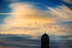 Skywatch (Andy Marfia) Tags: winter sunset sky chicago church clouds plane airplane iso200 jet steeple f8 westward rogerspark 1640sec d7100 1685mm