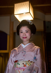 16 Years old maiko called chikasaya in her geisha house, Kansai region, Kyoto, Japan (Eric Lafforgue) Tags: woman white lamp beautiful beauty face japan vertical female hair asian japanese clothing eyes kyoto colorful asia pretty feminine painted young culture makeup front grace indoors teen maiko geisha teenager kimono gion tradition oriental youngadult solitary hairstyle youngwoman apprentice oneperson elaborate kanzashi lookingatcamera 1617years oneyoungwomanonly waistup 1people kansairegion japaneseethnicity colourpicture japan161674 chikasaya komayaokiya
