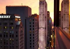 Hanging Out The Window (KaDeWeGirl) Tags: newyorkcity sunset reflection window manhattan rockefellercenter midtown burberry gebuilding