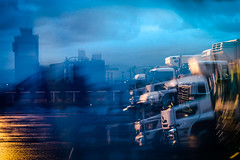 Le Jour Parfait (www.danbouteiller.com) Tags: japan japon japonia hakodate hokkaido port night blue orange bleu sky clouds cloud cloudy camion trucks blur blurred pavement industrial indus canon canon550d 50mm14 50mm 550d eos bynight nocturne nocturnal nuit