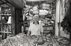 I sell clothings (denise yeap) Tags: blackandwhite film senior monochrome analog uncle traditional oldschool fujifilm analogue 135 neopan400 blacknwhite chowkit trader klassew filmnotdead filmneverdie