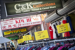 Springvale (Adam Dimech) Tags: ckcollections kimheng shop shopping footpath sidewalk clothes retail discount multicultural asian society shutters springvale melbourne victoria australia timvng ph